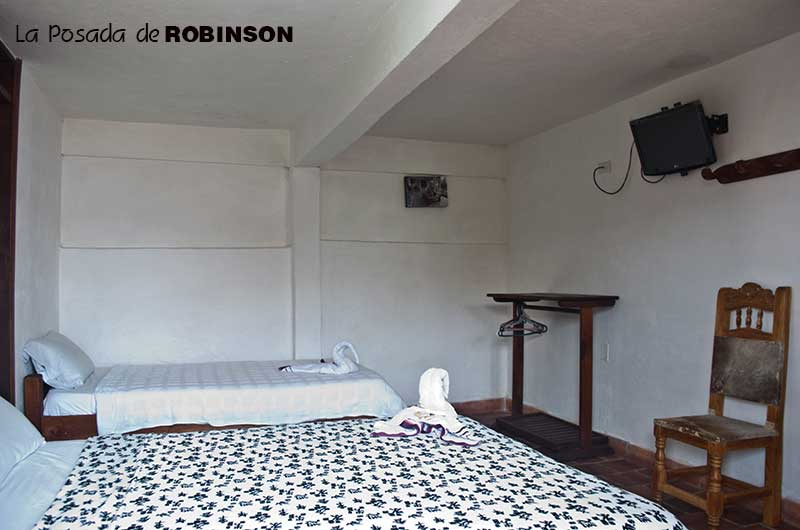habitacion3personaslaposadaderobinson1.jpg